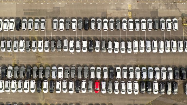 ELLESMERE PORT,  - MARCH 17:  Recently assembled Vauxhall vehicles are stored in the distribution yard at the Vauxhall car factory on March 17, 2020 in Ellesmere Port, England. The carmaker's parent company, PSA Group, said its plants would remain closed through March 27, citing a drop in demand and supply-chain disruption due to the COVID-19 outbreak. (Photo by Christopher Furlong/Getty Images)