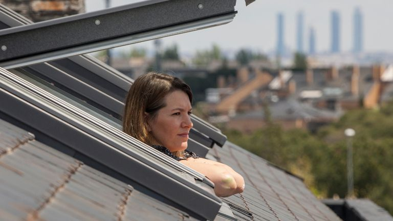 MAJADAHONDA, MADRID - APRIL 25: Virginia Béjar, the wife of the photographer, looks out the window in her attic on April 25, 2020 in Majadahonda, Madrid, Spain. Children in Spain, which has had one of the stricter lockdowns in Europe, are now allowed to leave their homes for up to an hour per day. The country has had more than 220,000 confirmed cases of COVID-19 and over 20,000 reported deaths, although the rate has declined after weeks of quarantine measures. (Photo by Miguel Pereira/Getty Images)