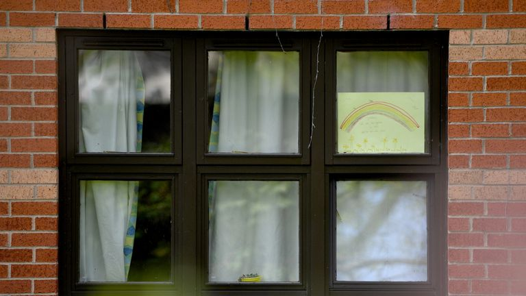A rainbow poster, used as a symbol of hope during the coronavirus pandemic, is seen in the window at MHA Laurel Court care home in Manchester, northwest England, on April 15, 2020. - The reported COVID-19 death toll in the UK passed the 12000 mark as fears grow about the true number of deaths in UK care homes, with charities sounding the alarm that there have been many more fatalities than reported. (Photo by Anthony Devlin / AFP) (Photo by ANTHONY DEVLIN/AFP via Getty Images)