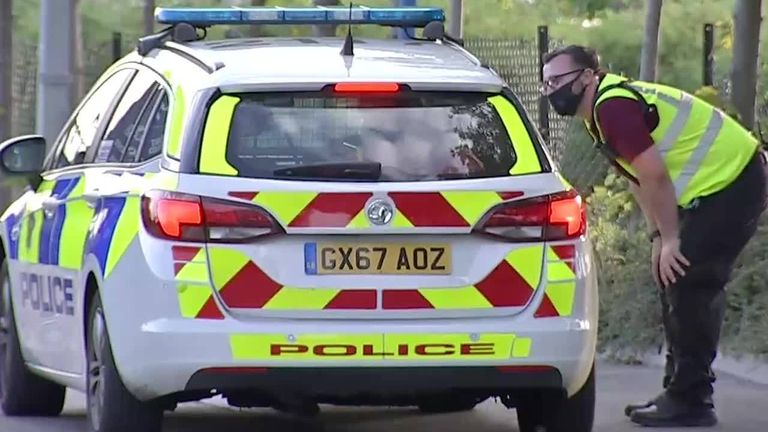 Police arrive at Thorpe Park to investigate stabbing incident.