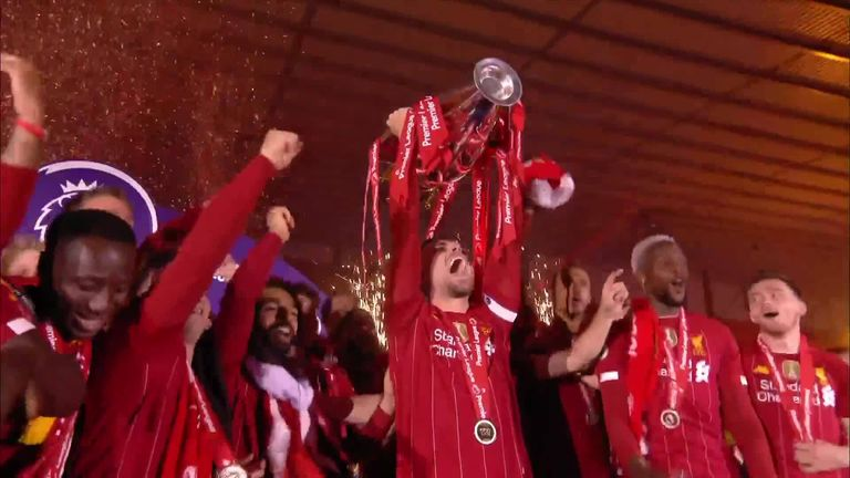 Liverpool's Jordan Henderson lifts the Premier League trophy for the first time in the club's history