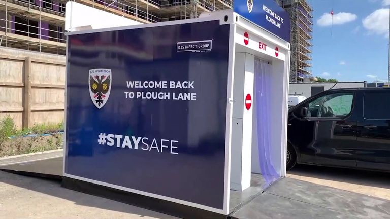 AFC Wimbledon have been using a walk-through disinfectant tunnel while building their new ground, but could it hold the key for mass crowds to return to sporting  venues?