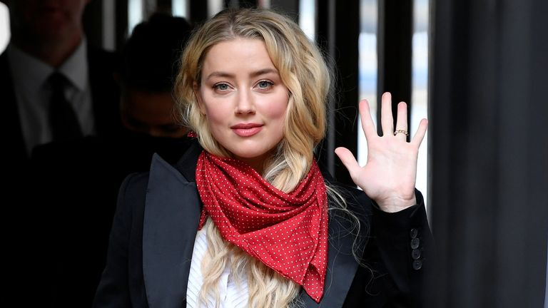 Actor Amber Heard waves as she arrives at the High Court in London, Britain July 14, 2020. REUTERS/Toby Melville