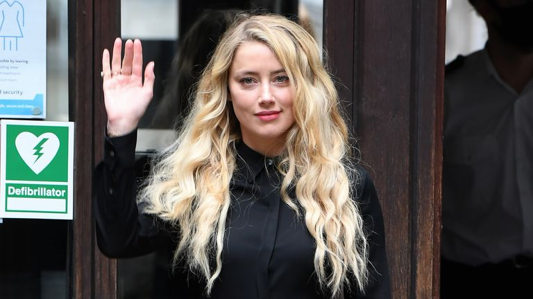 "LONDON, ENGLAND - JULY 28: Amber Heard arrives at the Royal Courts of Justice, the Strand on July 28, 2020 in London, England. The Hollywood actor Johnny Depp is suing News Group Newspapers (NGN) and the Sun's executive editor, Dan Wootton, over an article published in 2018 that referred to him as a ""wife beater"" during his marriage to actor Amber Heard. (Photo by Stuart C. Wilson/Getty Images)"