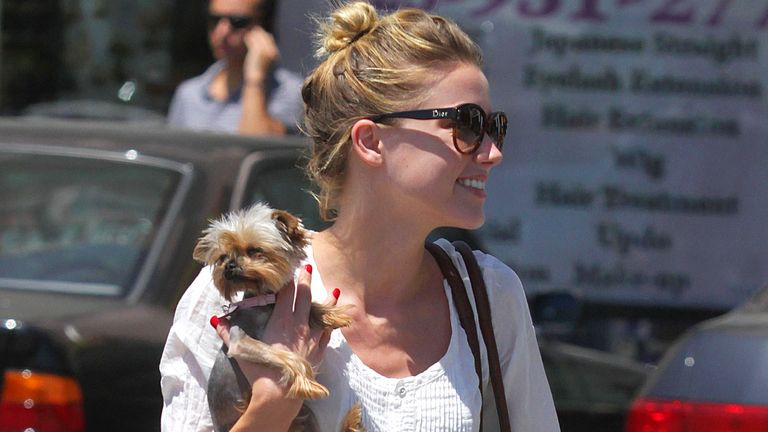 Amber Heard with her dog Pistol in 2010. Pic: Startraks/Shutterstock