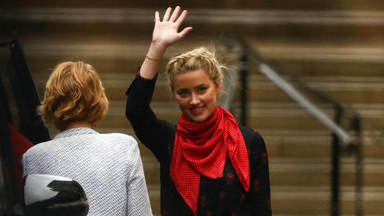 Actor Amber Heard waves as she leaves the High Court in London, Britain July 15, 2020. REUTERS/Hannah McKay