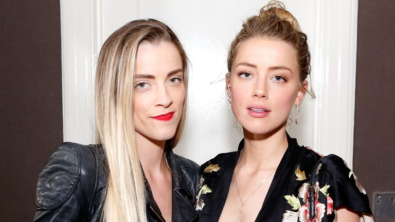Whitney Heard (L) and Amber Heard attend the Art of Elysium presents Tom Franco at the art salon on May 7, 2016 in Los Angeles, California