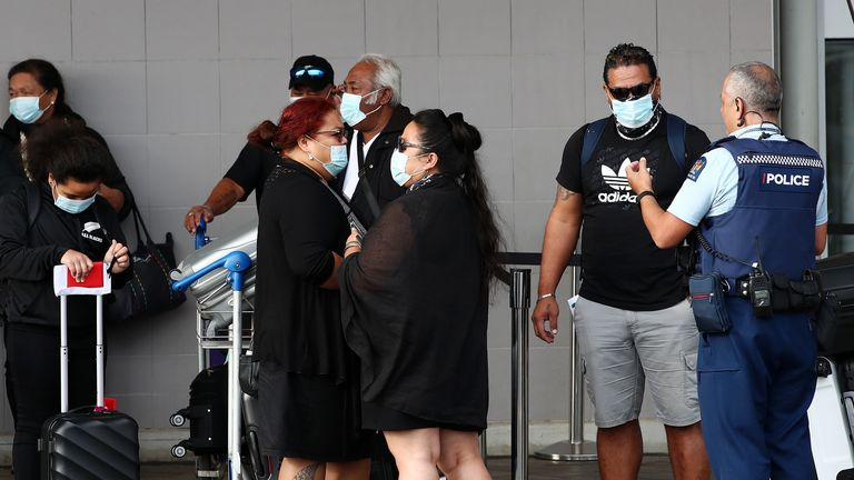 Police speak to passengers at Auckland International Airport on April 08, 2020 in Auckland, New Zealand