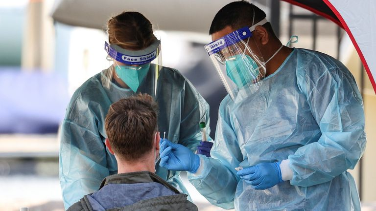 Medical personnel administer tests for coronavirus at a pop-up centre in Sydney
