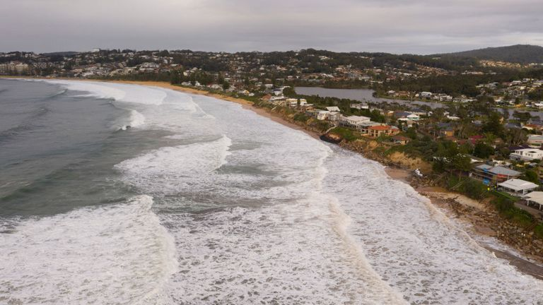 The large swells pushed right up the beach in Wamberal on Australia's Central Coast