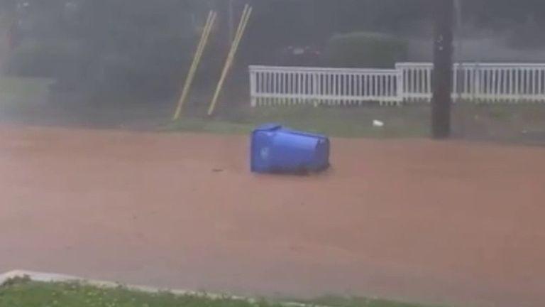 Bin floats away as heavy rain hits Atlanta