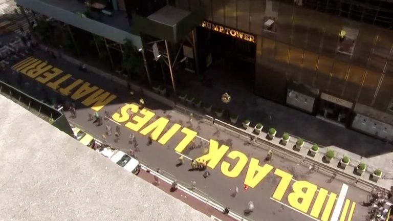 Black Lives Matter is painted on Fifth Avenue outside Trump Tower