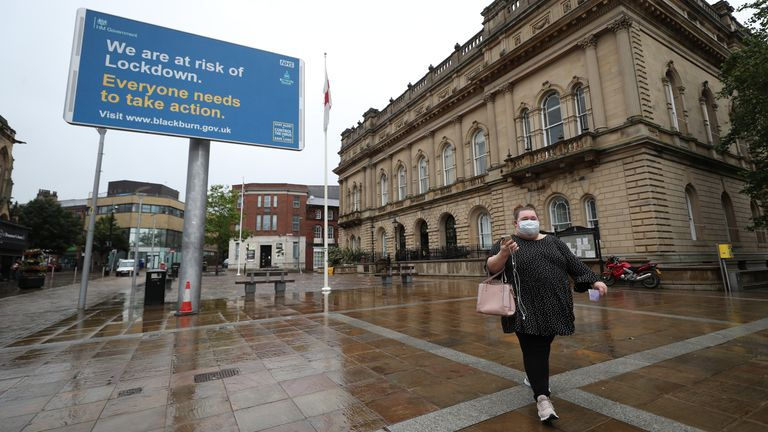 A warning from the government is seen outside Blackburn Town Hall