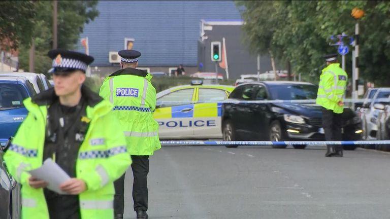 Officers were seen searching houses in Bridgeman Street, Bolton