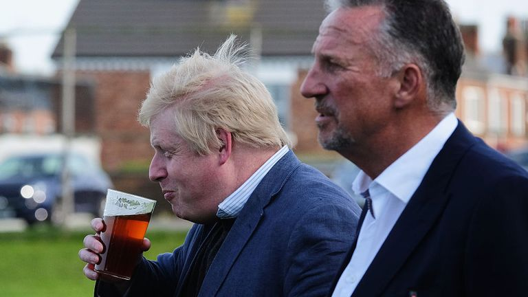 Sir Ian Botham, inset, appeared alongside Boris Johnson, also pictured, before the EU referendum