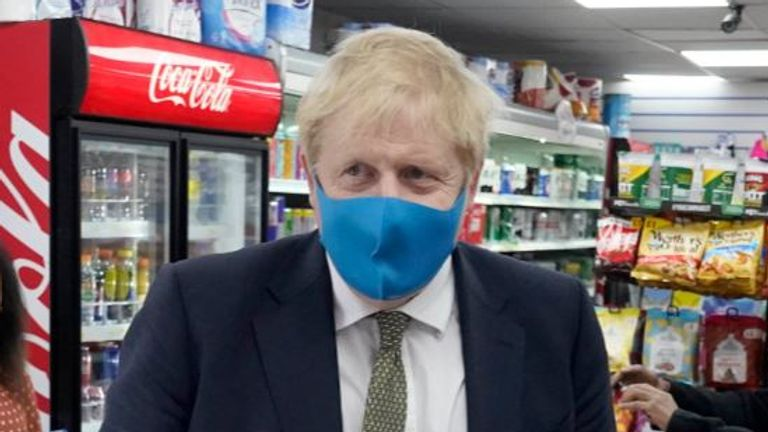 Boris Johnson was seen wearing a mask for the first time on Friday. Pic: Twitter