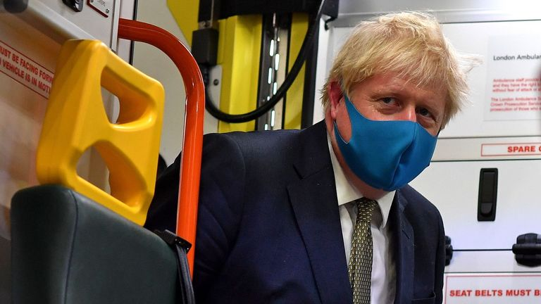 Britain's Prime Minister Boris Johnson, wearing a face mask or covering due to the COVID-19 pandemic, boards an ambulance to talk with a paramedic, during his visit to the headquarters of the London Ambulance Service NHS Trust in central London on July 13, 2020. (Photo by Ben STANSALL / various sources / AFP) (Photo by BEN STANSALL/AFP via Getty Images)