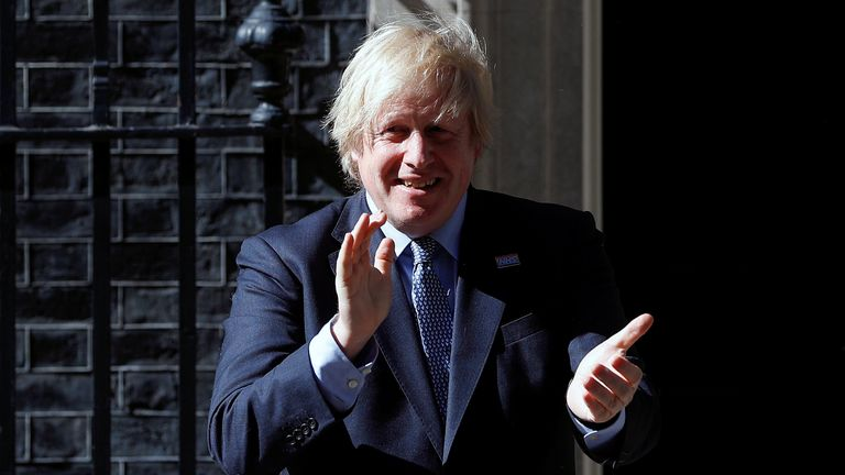 Britain's Prime Minister Boris Johnson applauds outside 10 Downing Street on the occasion of the 72nd anniversary of the NHS, amid the coronavirus disease (COVID-19) outbreak, in London, Britain, July 5, 2020. REUTERS/Peter Nicholls