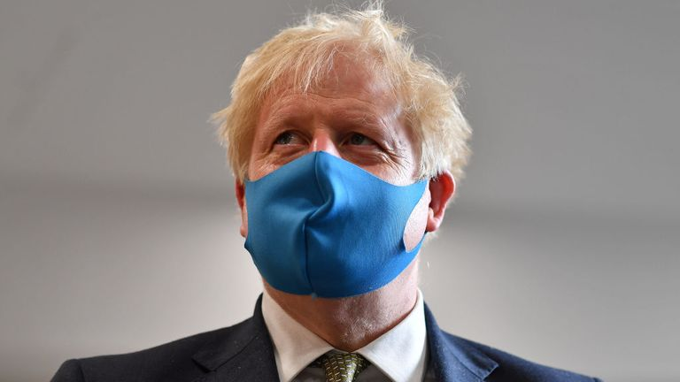 Boris Johnson, pictured here wearing a mask in London, has played down the prospect of a second national lockdown