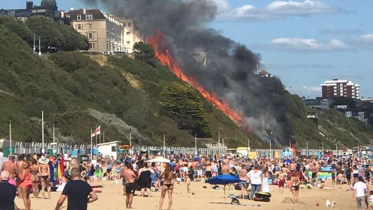 Crowds watched as the flames shot above the beach. Pic: @missberkova