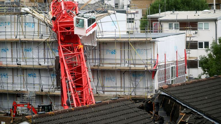 A collapsed crane is seen near a construction site in Bow, east London, Britain, July 8, 2020. REUTERS/Hannah McKay
