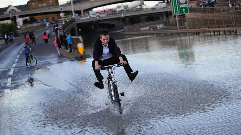 A schooboy was seen riding his bike over the water of the North Circular