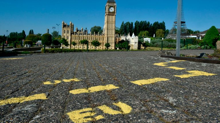 Ground markings are seen at the mock border of the United Kingdom and the European Union during the reopening of the 'Mini-Europe' theme park of small-scale models of European capitals and their landmarks, in Brussels on May 20, 2020
