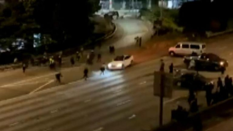 One person has died after two people were struck when a car drove at speed around a barrier at a protest site in Seattle.