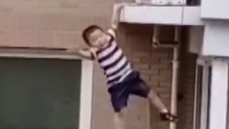 Heroic local miraculously catches falling infant from fifth floor apartment building
