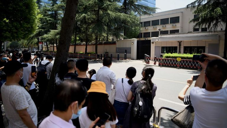 People look at the US Consulate in Chengdu in southwestern China's Sichuan province