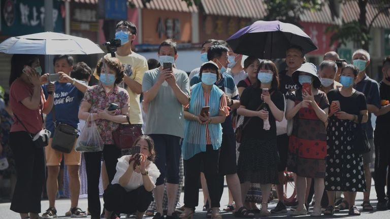 People stand on a road leading to the US consulate in Chengdu