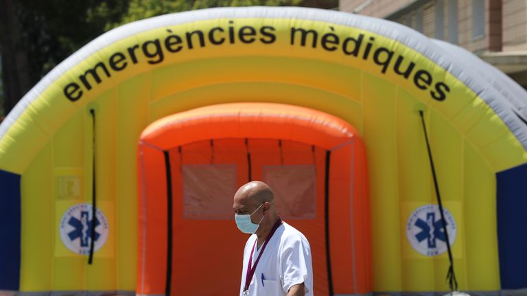 A health worker in the Spanish city of Lleida, which has gone back into lockdown