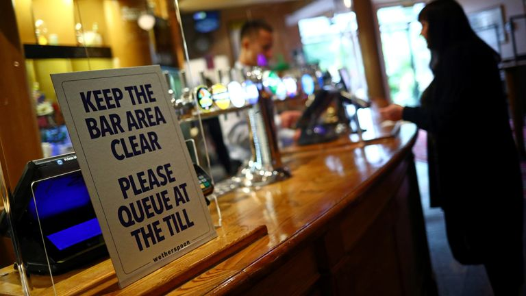 A sign is pictured at The Holland Tringham Wetherspoons pub after it reopened following the outbreak of the coronavirus disease (COVID-19), in London, Britain July 4, 2020. REUTERS/Hannah McKay