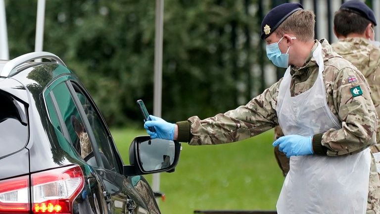 LEICESTER, ENGLAND - JUNE 29: Soldiers from the Royal Logistics Corp operate a mobile coronavirus (Covid-19) testing site at Evington Leisure Centre on June 29, 2020 in Leicester, England. In a television appearance on Sunday, British Home Secretary Priti Patel confirmed the government was considering a local lockdown after a spike in coronavirus cases in the city. The city's mayor has said that Pubs and restaurants in Leicester may stay closed for two more weeks due to a recent surge in coronav