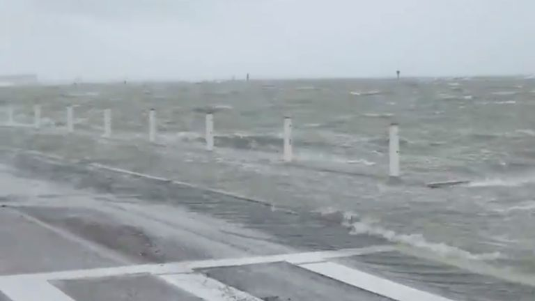 A storm surge swells in Corpus Christi Bay as Hurricane Hanna approaches