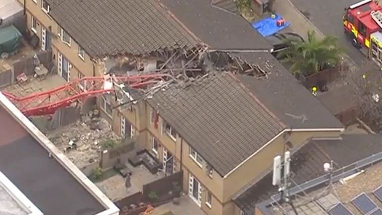 Damage done by falling crane on a house in London