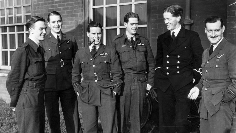 Wing Commander Guy Gibson (smoking a pipe) led the Dambusters raid in 1943