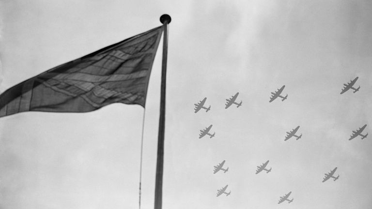 Bomber Command Lancasters, which took the war to the heart of Nazi Germany, fly in formation over the Union Jack.