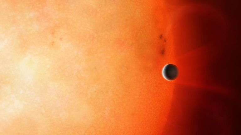 Artist's impression showing a Neptune-sized planet in the Neptunian Desert. It is extremely rare to find an object of this size and density so close to its star. Credit: University of Warwick/Mark Garlick