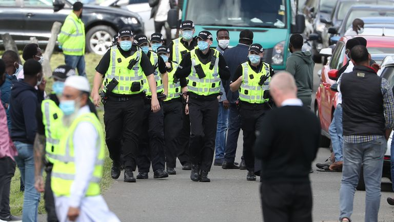 Police ensure mourners leave the graveyard ahead of the funeral of Badreddin Abadlla Adam, who stabbed six people in West George Street, takes place at Linn Cemetery in Glasgow. Police ensured there was the correct amount of mourners in the graveyard as per government guidelines. July 18.