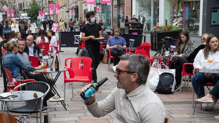 Customers enjoy their first drink at the Americian NY Grill's outdoor area on Buchanan Street, Glasgow, as outdoor areas reopen to the public for the first time as Scotland continues with the gradual lifting of restrictions to ease out of lockdown.