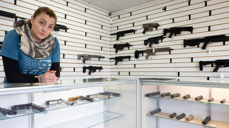 Tiffany Teasdale in front of mostly empty shelves at Lynnwood Gun in Washington State following a big increase in sales