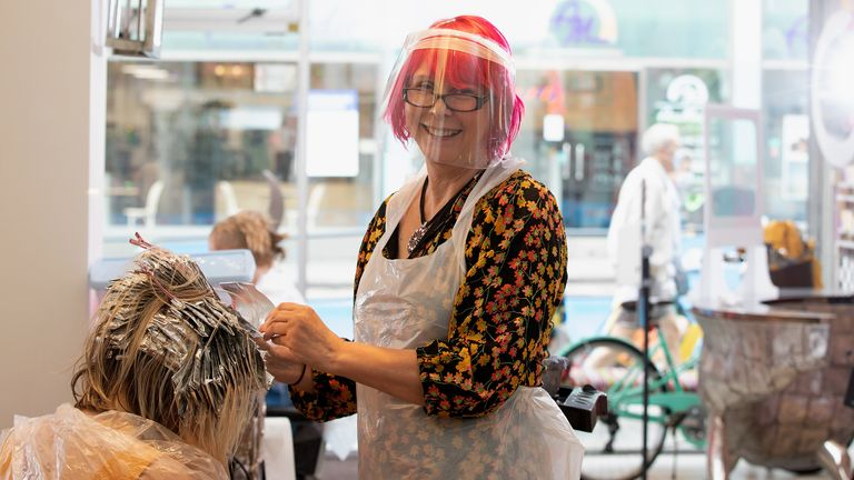 Tusk Hair Salon owner and hairdresser Carole Rickaby colours her client's hair in Camden on July 04, 2020 in London, England
