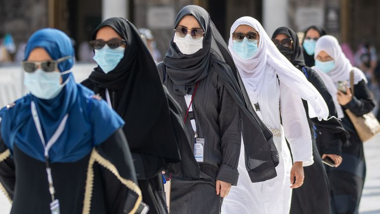 Pilgrims wear masks at the centre of the Grand Mosque in the holy city of Mecca