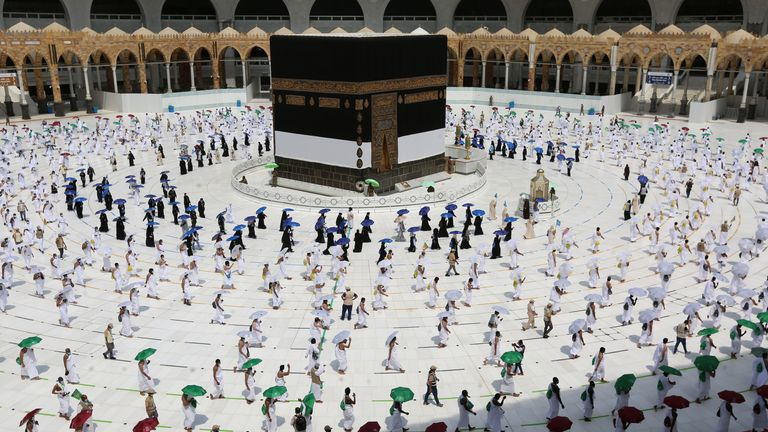 Socially-distanced pilgrims walk around the Kaaba at the centre of the Grand Mosque in Mecca