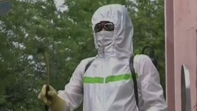 Sprays and hazmat suits have been deployed around Pyongyang after COVID-19 is suspected to have entered the country.