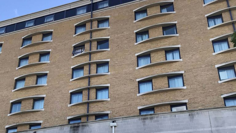 A broken window could be seen on the fifth floor of the Holiday Inn hotel in Greenwich