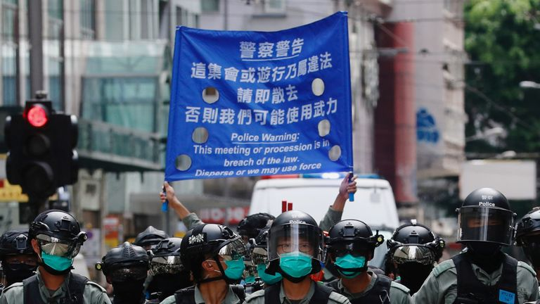 Riot police officers walk as anti-national security law protesters march during the anniversary of Hong Kong's handover to China from Britain, in Hong Kong, China July 1, 2019. REUTERS/Tyrone Siu