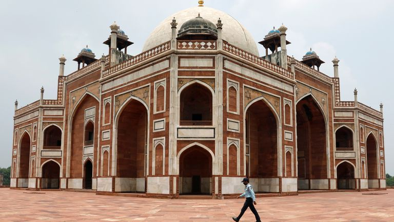 A security guard walks in front of Humayun's Tomb, after authorities reopened it for visitors following a three-month lockdown that was imposed to slow the spread of the coronavirus disease (COVID-19), in New Delhi, India July 6, 2020. REUTERS/Adnan Abidi