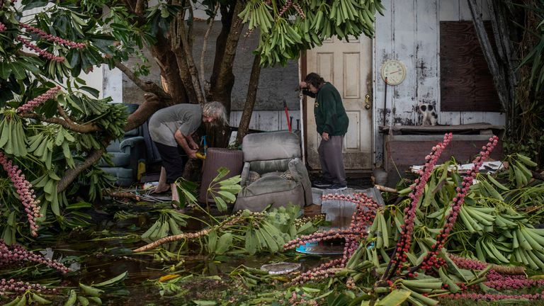 Charles Pecce, 70, and wife Sharon Pecce, 76, clear debris after returning to their destroyed home in the aftermath of Hurricane Hanna in Port Mansfield, Texas, U.S., July 26,